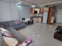 Выставлена на продажу просторная, 2-х комнатная квартира в районе Коньяалты.